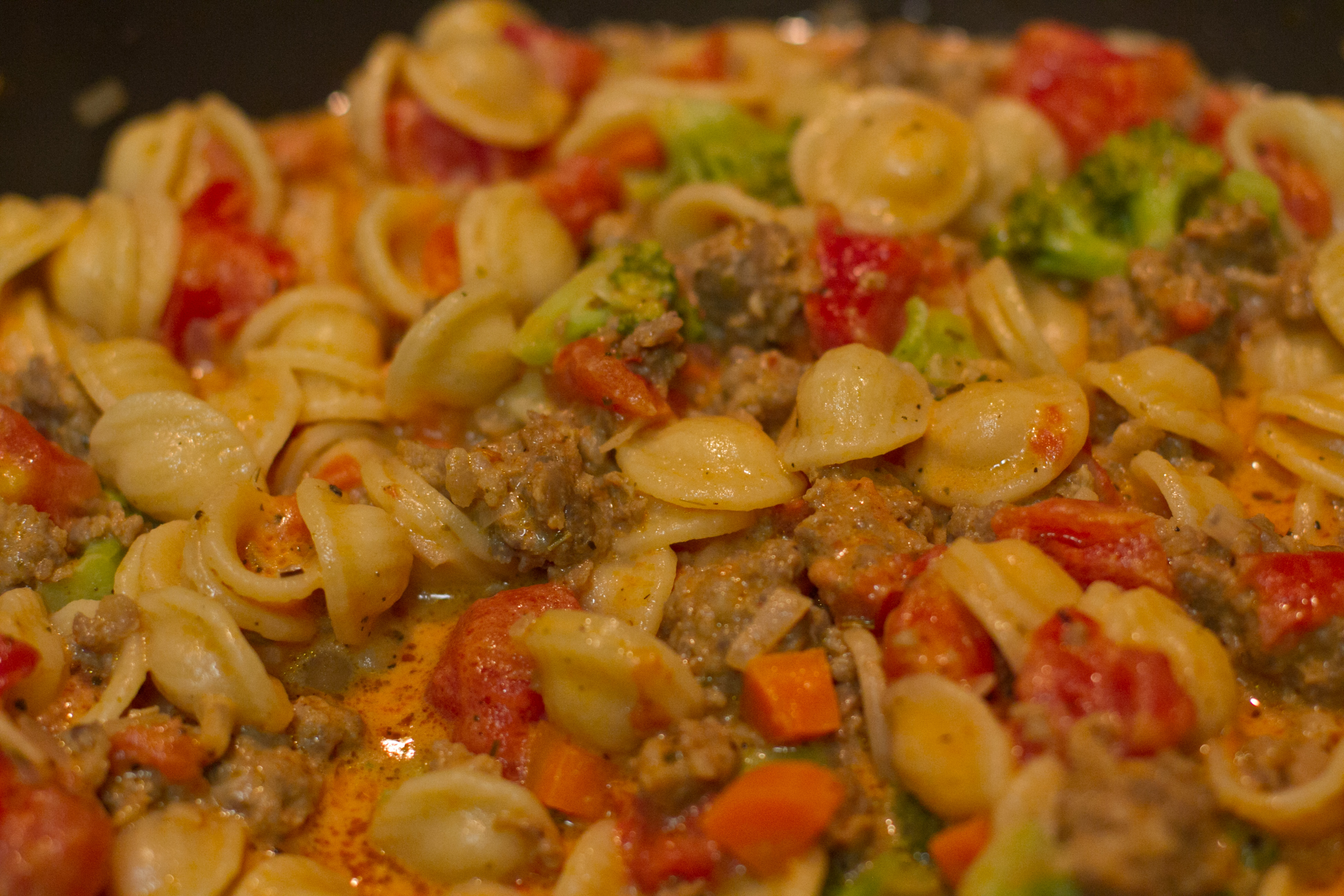 Pasta with Spicy Sausage and Vegetables in Tomato Cream Sauce ...